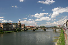 Bridge over Arno river. Scenic view of bridge over Arno river with blue sky and cloudscape background, Florence, Tuscany, Italy Royalty Free Stock Photo