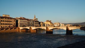 Bridge over the Arno River in Florence. Evening time stock video footage