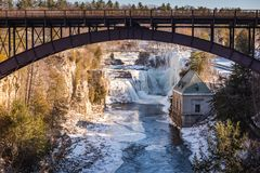 Bridge over Ausable Chasm - Keeseville, NY. Iron bridge over Ausable River at Ausable Chasm, a 2 mile gorge in the Adirondacks of Upstate New York known as the Royalty Free Stock Photo