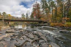 Bridge over an Autumn River Stock Photo