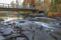 Bridge over an Autumn River Stock Photos