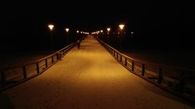The bridge over Baltic sea on winter Stock Photos