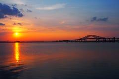 Bridge over a bay. Sunset landscape of a bridge extending over Newark bay stock photo