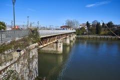 Bridge over the Bidasoa river on Spain and France border. Hendaye, France - January 28, 2018. Railway bridge over the Bidasoa river on Spain and France border royalty free stock photo