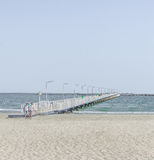The bridge over Black Sea, seafront and seaside with blue water and gold sand Royalty Free Stock Photography