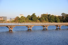 Bridge over blue water in city lake Stock Images
