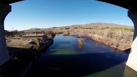 Bridge over the Boise river in the spring stock footage