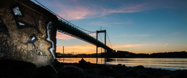 Bridge over calm waters. Calm sunset in gothenburg harbor Stock Photos