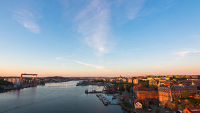 Bridge over calm waters. Calm sunset in gothenburg harbor Royalty Free Stock Photography