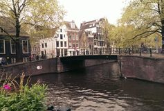 Amsterdam bridge over canal Royalty Free Stock Images