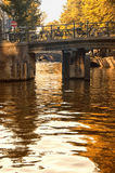 Bridge over a canal in Amsterdam. A little bridge over a canal in the neighborhood of Amsterdam called Jordaan stock photography