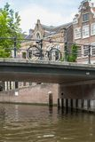 Bridge over canal in Amsterdam Royalty Free Stock Photos