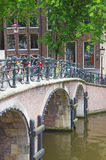 Bridge over canal with bicycles  in Amsterdam Royalty Free Stock Photo