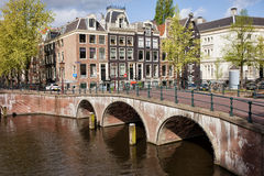 Bridge over Canal and Houses in Amsterdam Royalty Free Stock Photos