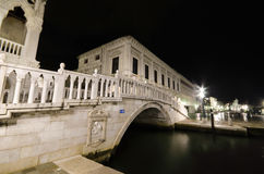 Bridge over canal at night in Venice Stock Photography