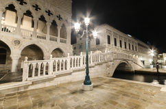 Bridge over canal at night in Venice Stock Image