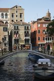 Bridge over canal in Venice, Italy. stock photography