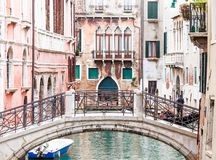 Bridge over a canal in Venice Stock Images