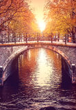 Bridge over channel in Amsterdam Netherlands autumn Royalty Free Stock Images
