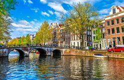 Bridge over channel in Amsterdam Netherlands houses river Amstel Royalty Free Stock Image