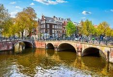 Bridge over channel in Amsterdam Netherlands houses river Amstel Stock Image