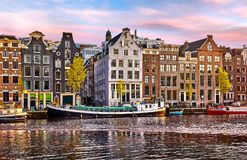 Bridge over channel in Amsterdam Netherlands houses river Amstel landmark old european city spring landscape. Royalty Free Stock Images