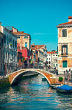 Bridge over channel among houses in Venice Stock Photos