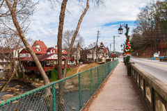 Bridge over Chattahoochee river, Helen, USA. Helen, Georgia, USA - December 14, 2016: The bridge over the Chattahoochee river on the Main Street stock images