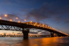 Auckland Harbour Bridge Frist Light. Bridge  over the City of Auckland a dawn Royalty Free Stock Photography