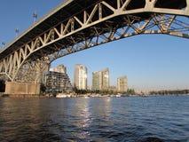 Bridge over City Skyline Stock Images