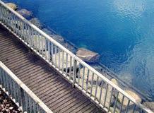 Bridge over clear lake Royalty Free Stock Image