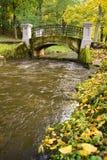 Bridge over the Creek in the city Park. Bridge over the Creek in the autumn city Park Stock Photography