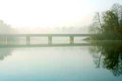 Bridge over a creek in the mist Stock Photography