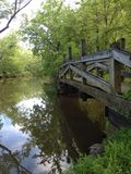 Bridge over creek Royalty Free Stock Photo
