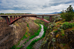 Bridge Over Crooked River in Oregon. Bridge over the expanse of the Crooked River and the Crooked River Canyon in Central or Eastern Oregon with the water stock photography