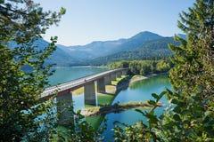 Bridge over dam lake sylvenstein, view through branches Royalty Free Stock Photography