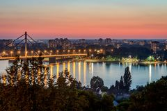 Bridge over the Danube. Liberty bridge over the Danube in Novi Sad, Serbia, photographed with street lighting during sunset Royalty Free Stock Images