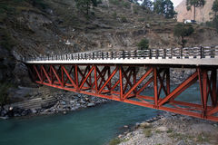 Bridge over deep green river Beas  in remote rural. New road and vehicle bridge over the Beas River as it flows through the high mountains and valleys of Stock Photography