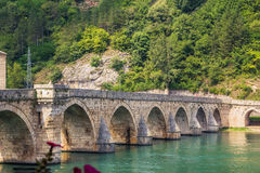 Bridge over Drina River in Višegrad. Famous Bridge over Drina, depicted by Serbian Nobel prize winner for literature, Ivo Andrić. Bridge is located in stock photography