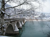 Bridge over Drina River in the winter in Bosnia Hercegovina on the border with Serbia. In Visegrad stock photos