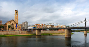 Bridge over Ebro river and catholic church in Tortosa Stock Images