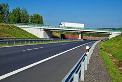 Bridge over empty highway in the countryside Stock Images