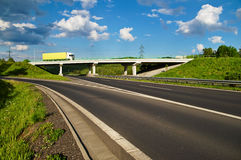 Bridge over an empty highway, going over the bridge truck Royalty Free Stock Image