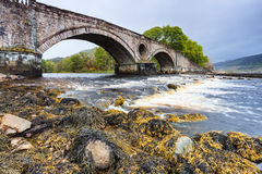 Bridge over a fast floating river Royalty Free Stock Photography
