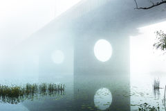 Bridge over foggy river Royalty Free Stock Images
