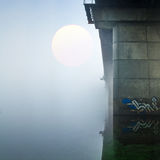 Bridge over foggy river Royalty Free Stock Photos