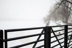 Bridge over frozen lake with Royalty Free Stock Photos