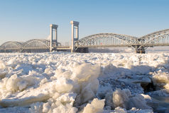 Bridge over the frozen river. In sunny day Royalty Free Stock Image