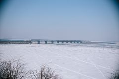Bridge over the frozen river in Cherkassy stock photo