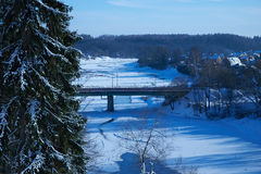 Bridge over the frozen river. The image of the bridge over the frozen river Royalty Free Stock Photography